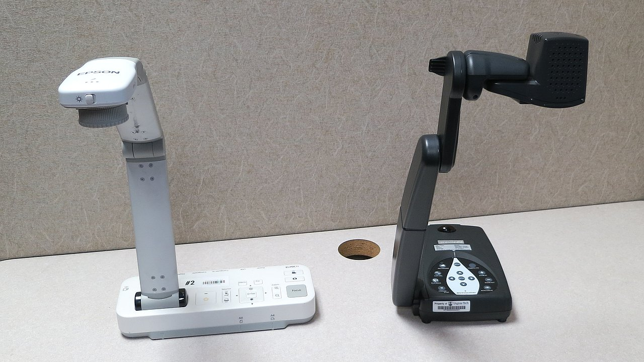 Tabletop document cameras with articulating heads