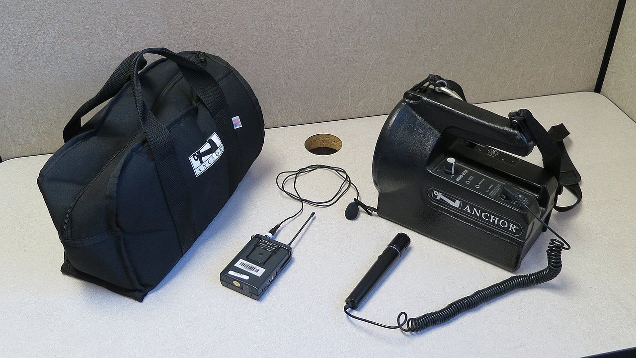 Small public address system with wired and wireless microphones and carrying case