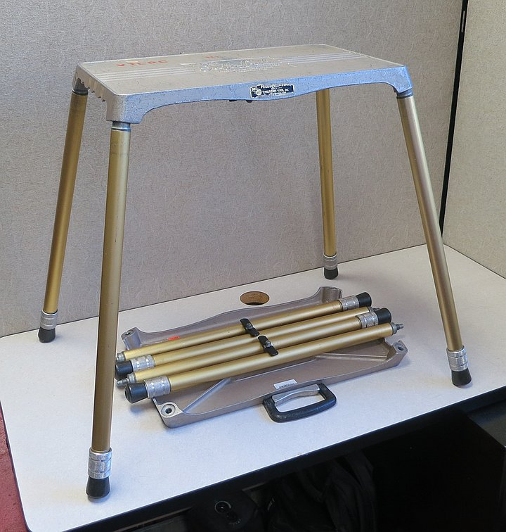 Small collapsible metal table with telescoping legs