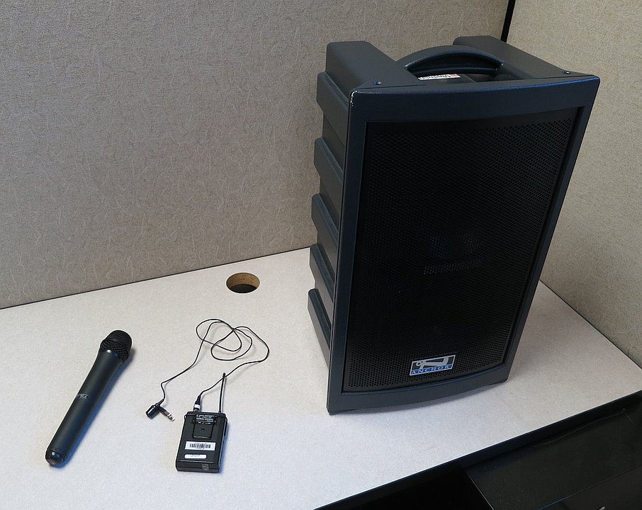 Large speaker with carrying handle and two wireless microphones